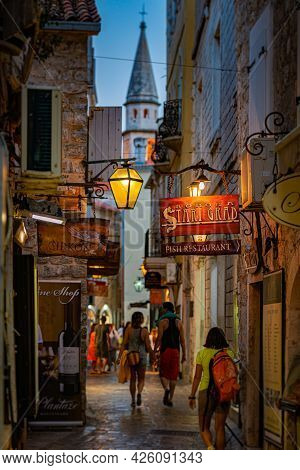 Budva, Montenegro - September 17, 2015: Old Town Street At Night With Shops And Cafes. Montenegro, B
