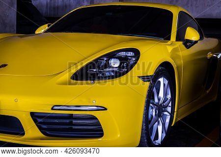 Bangkok, Thailand - 26 Jun 2021 : Close-up Of Car Headlights And Car Wheel Of Yellow Ferrari Sports