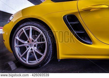 Bangkok, Thailand - 26 Jun 2021 : Close-up Of Wheel Of Yellow Ferrari Sports Car Parked In The Parki