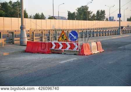 Road Repair. Road Signs Repair Work, Bypass Obstacles On The Right.