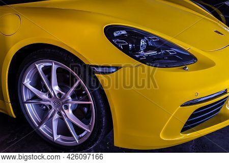Bangkok, Thailand - 26 Jun 2021 : Close-up Of Headlights, Wheel, And Rim Of Yellow Ferrari Sports Ca