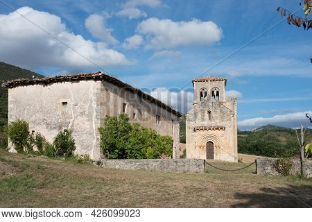 Ancient Church And Religious Building In A Rural Area. Blue Sky, No People. Merindades, Burgos, Spai