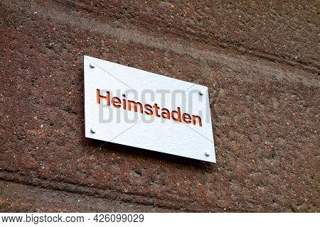 Havirov, Czech Republic - June 25, 2020: The Bright Silver Plate Of Heimstaden Company Ona Red Wall