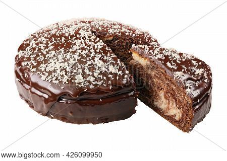 Glazed Cake Sprinkled With Coconut Flakes With Piece Cut Out Isolated On White Background.