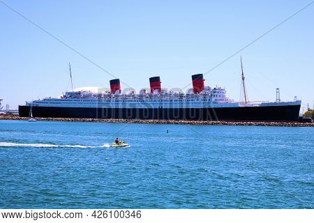 July 6, 2021 In Long Beach, Ca:  Person Jet Skiing Besides The Queen Mary Ship Taken In Long Beach,