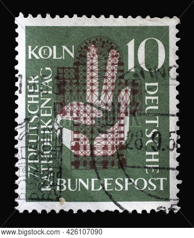 ZAGREB, CROATIA - AUGUST 29, 2014: Stamp printed in Germany, shows a hand raised to the oath in front of the floor plan of the Cologne Cathedral, 77th German Catholic Day in Cologne, circa 1956