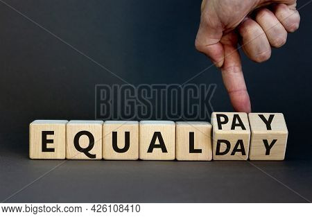 Equal Pay Day Symbol. Businessman Turns Wooden Cubes And Changes Words Equal Pay To Equal Day. Beaut