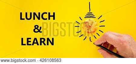Lunch And Learn Symbol. Businessman Writing Words 'lunch And Learn', Isolated On Beautiful Yellow Ba
