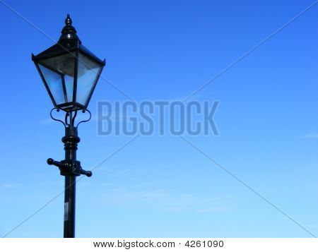 Black Victorian Lamppost Against Blue Sky