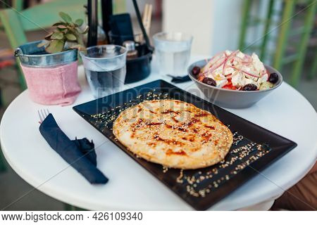 Greek Soft Pita, Stuffed With Cheese Sprinkled With Sesame Seeds Served With Greek Salad And Water I