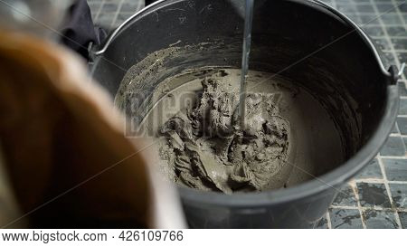 Wet Mortar Mixture For Finishing Work In Construction. Traces Of Tool Rotation. Construction Adhesiv
