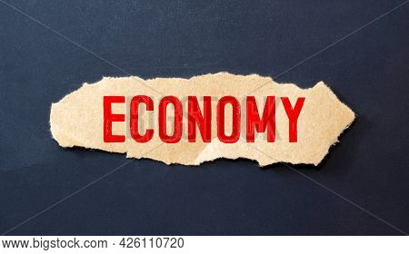 Economy Wording With Scattered Words With Small Pale On Black And White Background.business And Econ