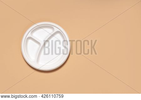 Three-piece Eco-friendly Cornstarch Dinner Plate On Beige Paper Background Close-up Copy Space, Eco-
