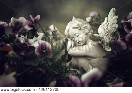 Close Up Of Guardian Angel And Spring Flowers
