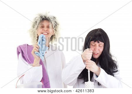 Female Cleaners In White Work Coats