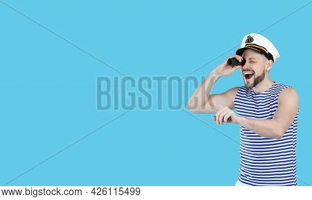 Sailor Looking Through Monocular And Pointing On Light Blue Background