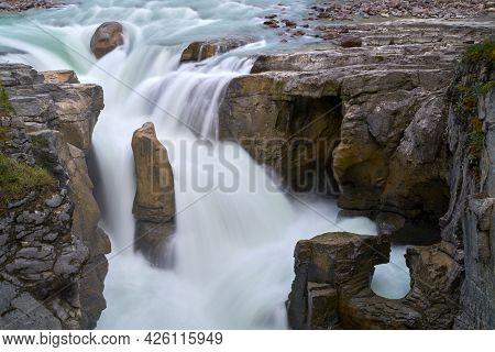 Jasper National Park Sunwapta Falls Alberta. Water Pours Over Sunwapta Falls. Jasper National Park.