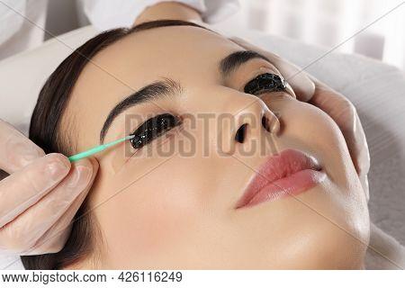 Young Woman Undergoing Eyelash Lamination And Tint In Salon, Closeup