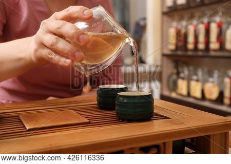 Master Conducting Traditional Tea Ceremony At Table, Closeup