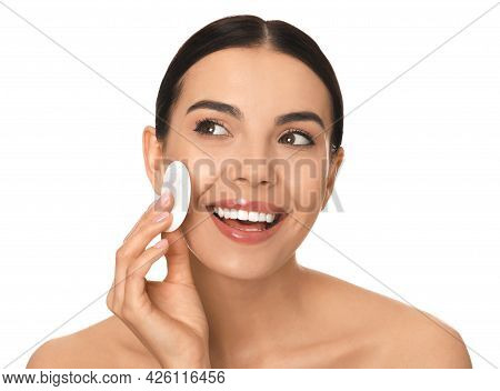 Beautiful Young Woman Applying Face Powder With Puff Applicator On White Background