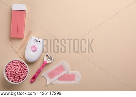 Set Of Epilation Products On Beige Background, Flat Lay. Space For Text