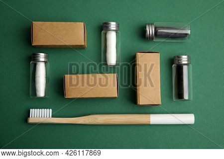 Flat Lay Composition With Natural Dental Floss On Green Background