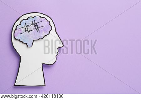 Top View Of Human Head Cutout With Brain On Violet Background, Space For Text. Epilepsy Awareness