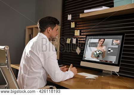 Professional Retoucher Working With Computer In Office