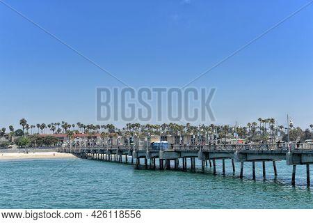 LONG BEACH, CALIFORNIA - 5 JULY 2021: The Belmont Vetrans Memorial Pier looking towards shore.