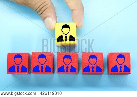 The Red Cube Of The Employee And The Yellow Cube Of The Leader Or Chief To Manage The Job