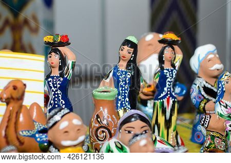Traditional Ceramic Figurines Of Uzbek Girls In National Clothes