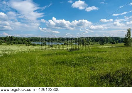 Beautiful Summer Landscape With A Field And A River And A Beautiful Cloudy Sky.