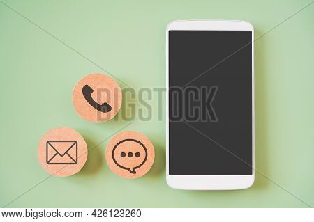 White Mobile Phone With Clipping Path On Touchscreen And Blurred Brown Contact Method Paper, Contact