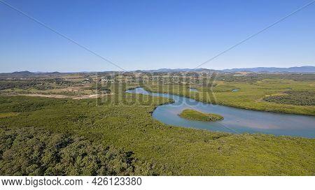 Aerial Of Conservation Park Which Runs Alongside A Creek. Sandringham Bay Conservation Park, Mackay,