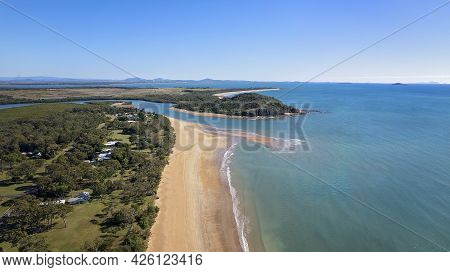 Aerial Landscape Of A Beach And Beachfront Community And Out Over The Ocean