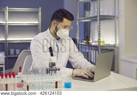 Medical Scientist Working On A Laptop While Doing Research In A Science Laboratory