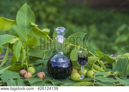 Liqueur From Young Green Walnuts, Remedy For Stomach Ache. Tincture Of Green Walnuts In A Glass Bott