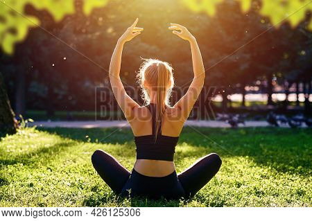 Yoga. Young Woman Practicing Yoga Meditation In Nature At The Park. Health Lifestyle Concept