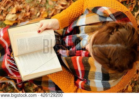 Student With A Book. Reading Books. Learning And Knowledge Concept. A Girl With An Open Book In Her