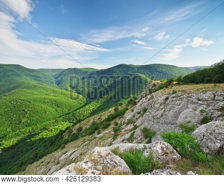 Green mountain hills during the sunset. Spring nature landsacape.