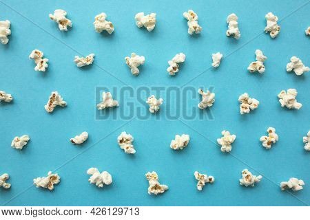 Popcorn Scattered On Blue Background. Popcorn Pattern. Top View.