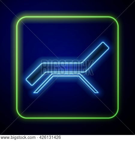 Glowing Neon Sunbed Icon Isolated On Blue Background. Sun Lounger. Vector