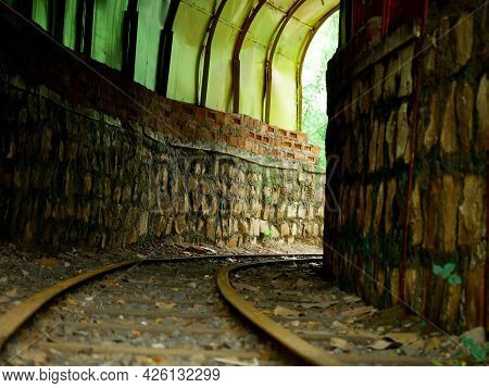 Small Train Roots With Cave Architecture View At Indian Garden.