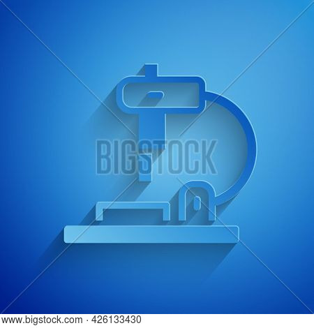 Paper Cut Microscope Icon Isolated On Blue Background. Chemistry, Pharmaceutical Instrument, Microbi