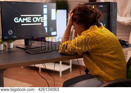 Angry Pro Gamer While Playing Shooter Games Beacuse She Losing. Gamer Over Of Mock-up Videogame Play