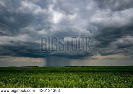Landscape With Dark Sky With Rain Clouds Before Storm. Thunderstorm Front