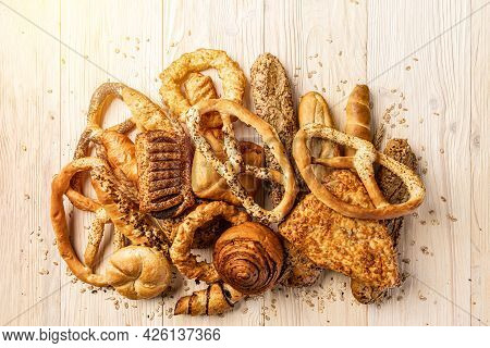 Bakery Product Assortment With Buns, Rolls Pretzels On Wooden Background