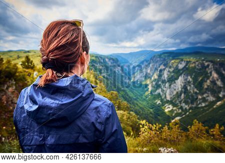 Woman in nature in vacation. People in nature. Hiker woman relaxing in nature in vacation. people. Happy people. Happy beautiful woman in nature in vacation. Woman sitting in meadow in vacation. Woman. People. Vacation. Nature.