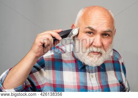 Mature Man With Hair Clipper. Old Bald Man Hair Clipper, Mature Baldness And Hair Loss Concept.