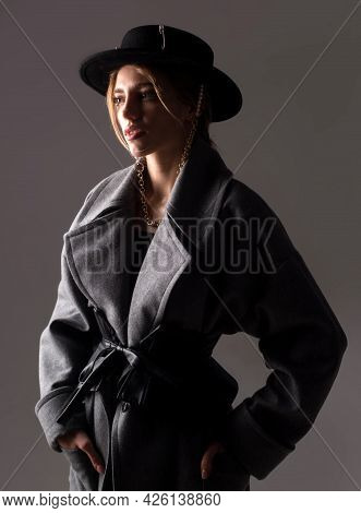 Fashion Woman Wearing A Black Round Hat. Fashion Portrait Of Glamour Sensual Young Stylish Lady Wear